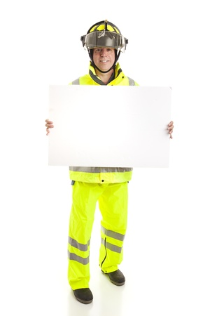 Fireman holding a blank white sign.  Full body isolated on white.   photo