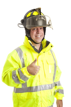 Friendly fire fighter geven de thumbs up teken.  Op wit wordt geïsoleerd. Stockfoto