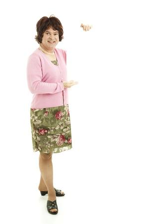 Humorous female impersonator holding blank white space.  Full body isolated on white.
