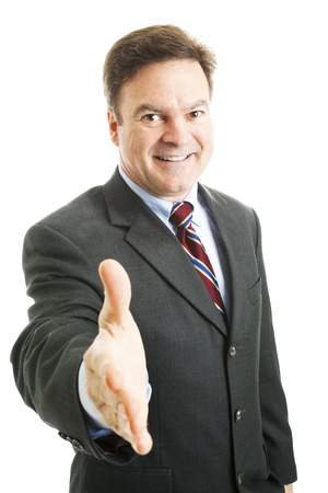 Friendly, mature businessman reaching forward to shake your hand.  Isolated on white.