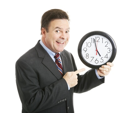 eagerly: Businessman eagerly pointing to a clock that reads almost 5:00 pm.  Hes ready to go home.  Isolated.