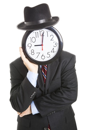 Businessman with an anonymous clock face, leaning on his hands in a bored posture.  Isolated on white.  photo