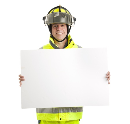 room for text: Fire fighter holding blank white sign.  Isolated on white with room for text.