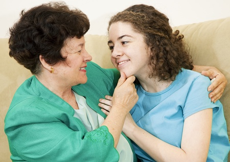 Affectionate mother together with her loving teenage daughter. Stock Photo - 9017515