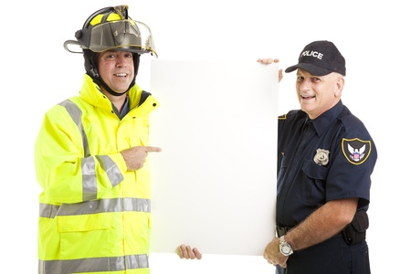 Firefighter and Policeman holding a blank white sign.  Isolated on white.