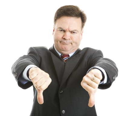 Businessman frowning and giving two thumbs down.  Isolated on white.   Stock Photo - 9077656