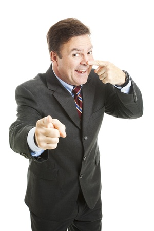 Businessman points to you and touches his nose - the symbol for youre right.  Isolated on white.   photo