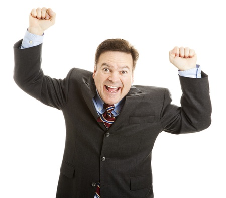 Excited businessman rasing his arms and cheering joyfully.  Isolated on white.