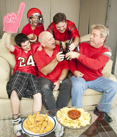 super dad: Sports fans toasting the win of their favorite football team.