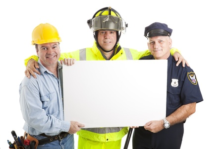 Construction worker, fireman, and policeman holding a blank white sign.  Isolated on white.   photo