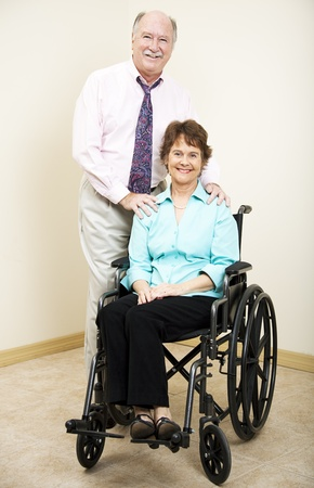 Business partners or married couple - the woman is in a wheelchair.   photo