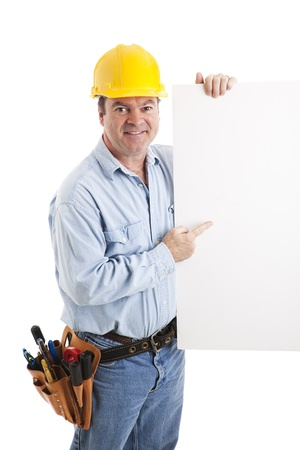 journeyman technician: Construction worker pointing to a blank white sign.  Isolated. Stock Photo