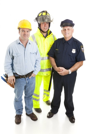 officers: Group of blue collar workers, construction worker, policeman, and fireman, isolated on white.   Stock Photo
