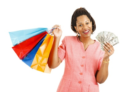 Beautiful african-american woman with cash to spend on a shopping spree.  Isolated on white photo