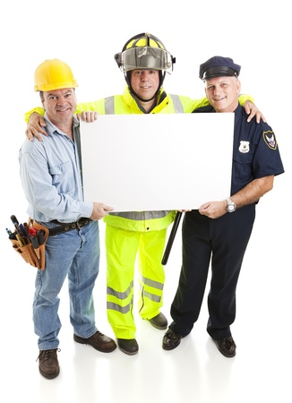 Blue collar workers - firefighter, policeman, and construction worker - all holding a blank sign, ready for your text.  Full body isolated.   photo