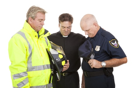 Minister prays with a firefighter and police officer at work.  Isolated on white.   photo
