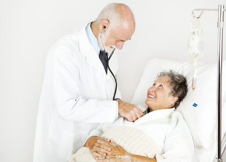 Smiling hospital patient gets examined by handsome doctor. Stock Photo - 9420935