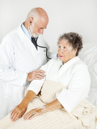 thorough: Senior hospital patient gets a thorough medical exam from her doctor.   Stock Photo