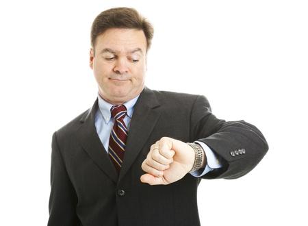 Impaziente imprenditore controlla l'orologio. Isolato su bianco.