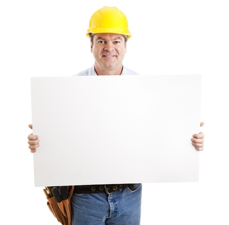 white collar worker: Friendly construction worker holding a blank, white sign.  Isolated on white.