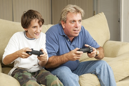 Father and son or uncle and nephew, playing video games at home.   photo