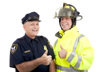 safety officer: Firefighter and police officer giving thumbs up sign.  Isolated on white.   Stock Photo