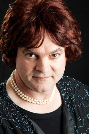 drag queen: Drag queen dressed as a female celebrity.  Portrait on black background.  Stock Photo