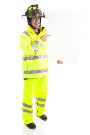 full uniform: Firefighter holding blank white sign.  Ready for your text.  Full body isolated on white.   Stock Photo
