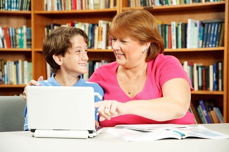 Student with learning disabilities gets one-on-one attention from a teacher.   Archivio Fotografico