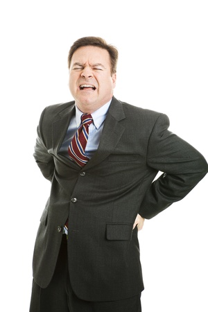 terrible: Businessman with a backache, in terrible pain.  Isolated on white.