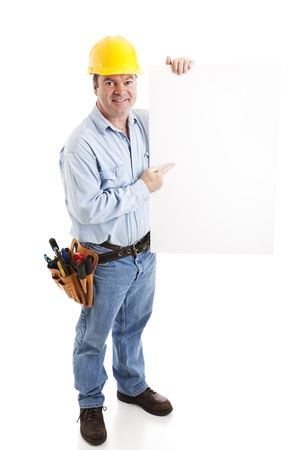Construction worker holding a blank white sign.  Isolated on white, full body.