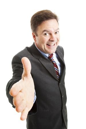 Opdringerige verkoper met een grote grijns, komen voor een handdruk.  Geïsoleerd op wit.   Stockfoto - 9969147