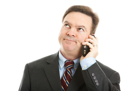 voicemail: Businessman rolling his eyes as he listens to a boring phone call or message.  Isolated on white.