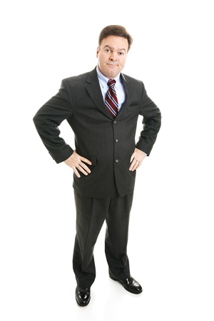 skepticism: Businessman with hands on hips and a skeptical expression.  Full body isolated.   Stock Photo