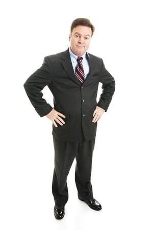 business skeptical: Hombre de negocios con las manos en las caderas y una expresi�n esc�ptica.  Cuerpo completo aislado.