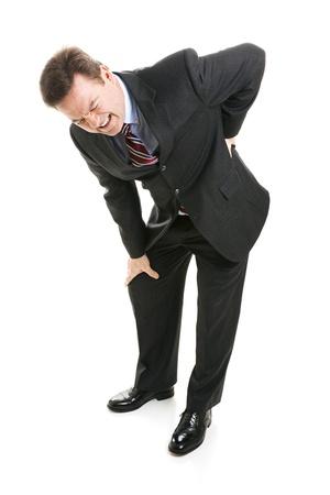 dolor de espalda: Hombre de negocios duplicado en dolor.  Ha desestimado su espalda.  Cuerpo completo aislado.