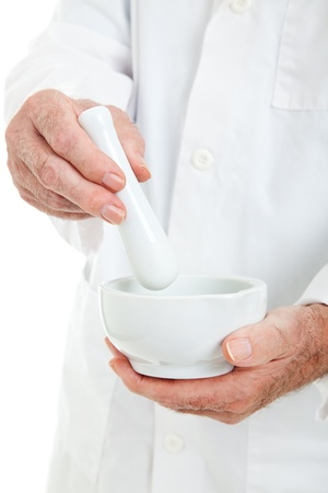 mortar and pestle medicine: Closeup view o a pharmacists hands, using a mortar and pestle.
