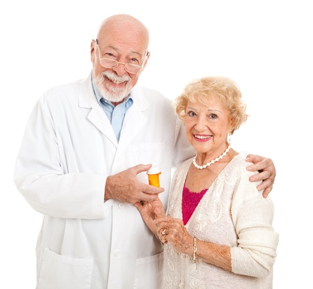 doctor holding pills: Friendly pharmacist and his customer.  Isolated on white.   Stock Photo