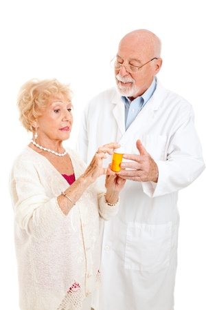Senior woman questions the pharmacist about her prescription medication.  Isolated on white. Stock Photo - 10104138
