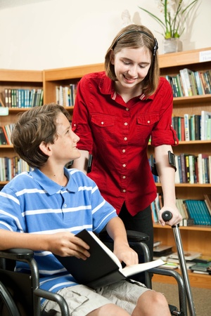 handicapped: Two disabled students inthe school library.