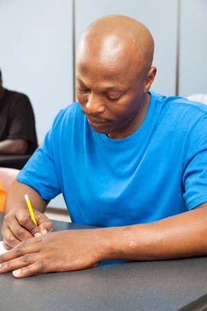 Handsome african-american college student taking a test.   Stock Photo - 10179269
