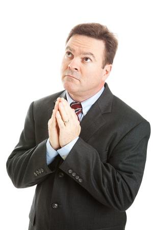 looking upwards: Christian businessman praying, looking upwards.  Isolated on white.