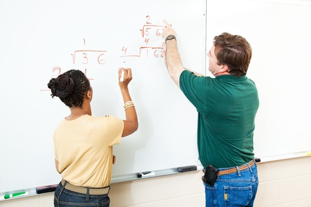 High school student and teacher at the white board doing long division.  Focus on the equations. Stock Photo - 10179253