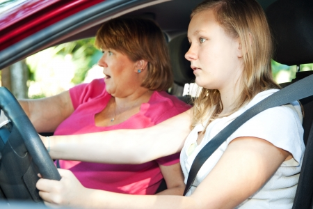 Teenage driver and her mother about to have a car accident.   Stockfoto