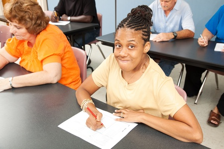 Young woman with cerebral palsy in college class.   photo