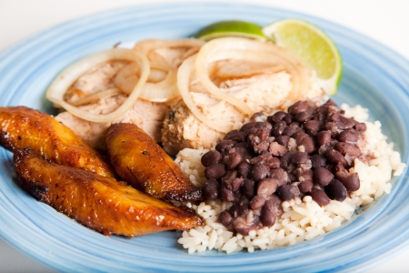 garnish: Traditional Cuban meal, of roast pork, black beans and rice, and sweet fried plantains.  Focus on the beans and rice, and the plantains.
