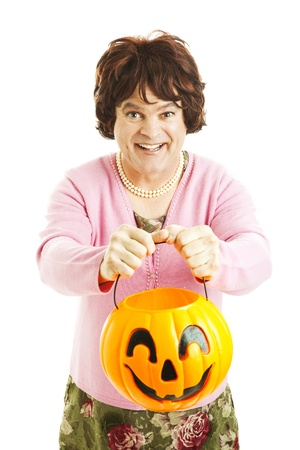 Man dressed as woman, trick-or-treating on Halloween.  Isolated on white.