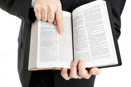 missionary: Businessman or minister holding a bible open to John 3:16.  White background. Stock Photo