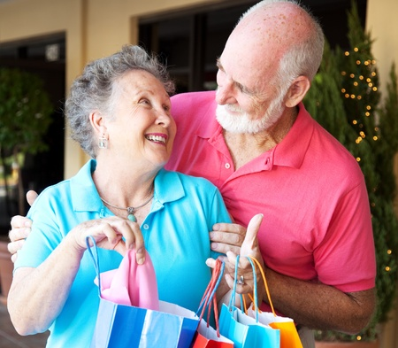 Happily married senior couple on a shopping strip together.   photo