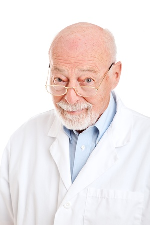 Wise senior man in a labcoat.  Could be pharmacist, doctor, or scientist.  Isolated on white.